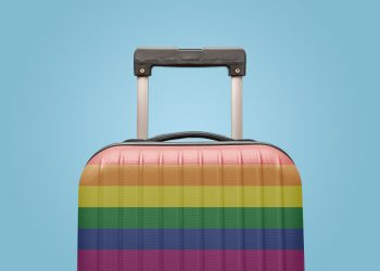 Suitcase with rainbow gay flag design travel concept.